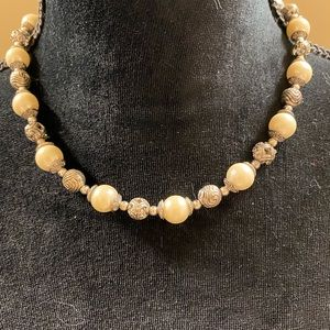 Silver and pearl beaded necklace.